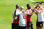 Nederland, Den Haag, 22 april 2012.Seizoen 2011/2012.Eredivisie.Ado Den Haag-Feyenoord.Guyon Fernandez van Feyenoord juicht na het scoren van de 0-2 en wordt gefeliciteerd doorzijn ploeggenoten