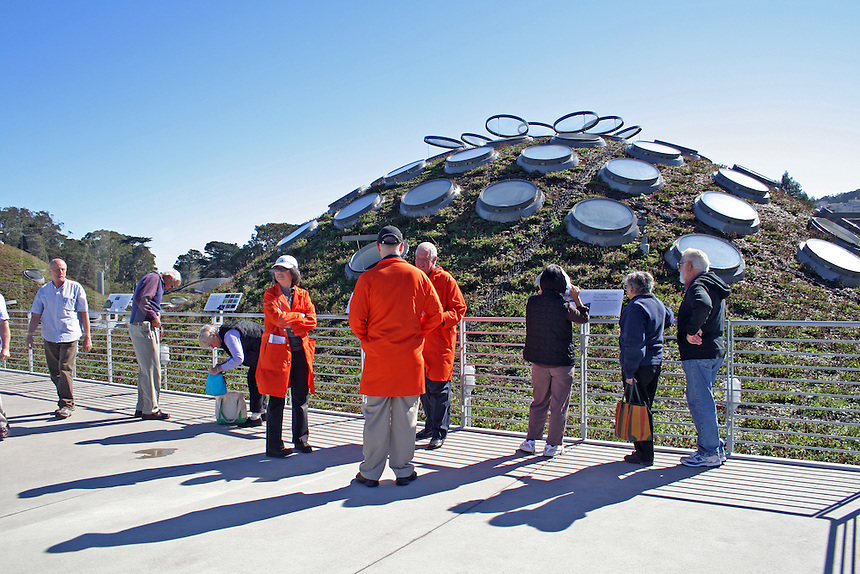 Orange coat tour guide The Living Roof, new California Academy of Sciences, San Francisco California