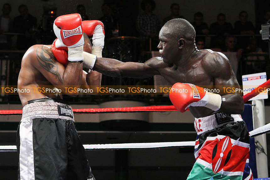 Erick Ochieng (mutlicoloured shorts) defeats Dee Mitchell in a Middleweight boxing contest at York Hall, Bethnal Green, promoted by Matchroom Sports - 09/11/11 - MANDATORY CREDIT: Gavin Ellis/TGSPHOTO - Self billing applies where appropriate - 0845 094 6026 - contact@tgsphoto.co.uk - NO UNPAID USE.
