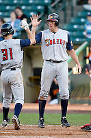 June 21, 2009:  Third Baseman Mike Hessman of the Toledo Mud Hens greets Scott Sizemore after scoring a run on Sizemores two run home run in the 11th inning to win the game at Frontier Field in Rochester, NY.  The Toledo Mud Hens are the International League Triple-A affiliate of the Detroit Tigers.  Photo by:  Mike Janes/Four Seam Images