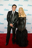 "ST. PAUL, MN JULY 16:  Scott Borchetta and Sandi Spika Borchetta pose on the red carpet at the Starkey Hearing Foundation ""So The World May Hear Awards Gala"" on July 16, 2017 in St. Paul, Minnesota. Credit: Tony Nelson/Mediapunch"
