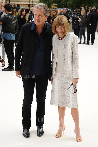 Mario Testino and US Vogue editor, Anna Wintour arriving for the Burberry Prorsum catwalk show as part of London Fashion Week SS13, Kensington Gardens, London. 17/09/2012 Picture by: Steve Vas / Featureflash