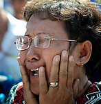 "A woman weeps outside a Phnom Penh court on December 14, 2012, after hearing that judges denied an appeal by Mam Sonando, a Cambodian radio journalist and human rights activist, who in October 2012 was sentenced to 20 years in prison for ""insurrection,"" despite international calls for his release."