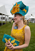 BALTIMORE, MD - MAY 20: A woman wearing a festive hat poses for a photo in the infield on Preakness Stakes Day at Pimlico Race Course on May 20, 2017 in Baltimore, Maryland.(Photo by Jesse Caris/Eclipse Sportswire/Getty Images)