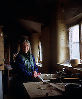 Lady O'Hagan in a dilapidated outhouse, its windows and furniture draped with ever encroaching cobwebs