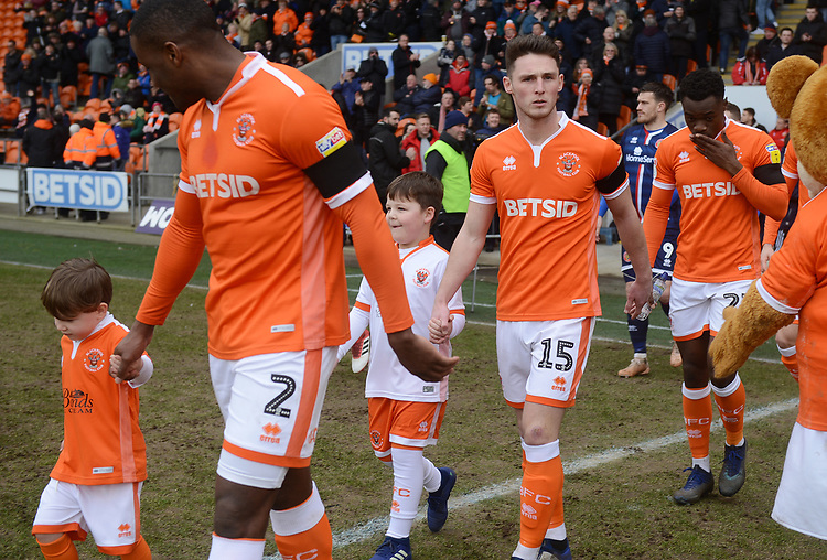 Blackpool's Jordan Thompson walks out with a mascot<br /> <br /> Photographer Kevin Barnes/CameraSport<br /> <br /> The EFL Sky Bet League One - Blackpool v Walsall - Saturday 9th February 2019 - Bloomfield Road - Blackpool<br /> <br /> World Copyright © 2019 CameraSport. All rights reserved. 43 Linden Ave. Countesthorpe. Leicester. England. LE8 5PG - Tel: +44 (0) 116 277 4147 - admin@camerasport.com - www.camerasport.com