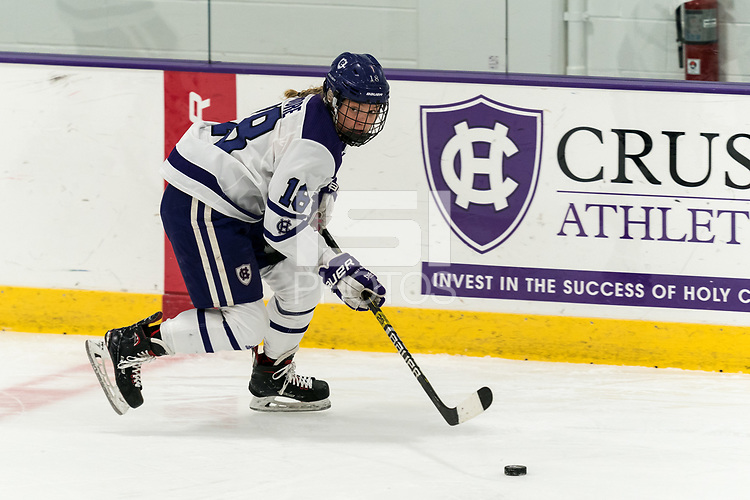 WORCESTER, MA - FEBRUARY 08: Rachel Moore #18 of Holy Cross brings the puck forward during a game between Boston University and College of the Holy Cross at Hart Center Rink on February 08, 2020 in Worcester, Massachusetts.