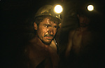 10 Mai 2005 - Mine de charbon, Kar-kar, Afghanistan.May 10, 2005 - Coal mine, Kar-kar, Afghanistan..Eclaires par le seul moyen de leur lampe du casque, les mineurs discutent sur les conditions de la galerie et de leur approche sur l'extraction du charbon - Lighted up by the only mean of a lamp on top of their helmet, the miners discuss on the conditions of the gallery and their approach on the extraction of the coal.
