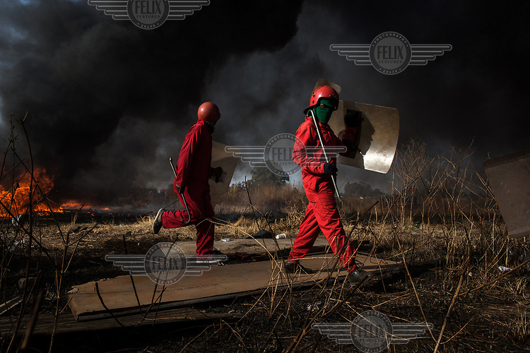 The Red Ants evict residents and destroy an informal settlement near Pomona. <br />The Red Ants are a controversial private security company often hired to clear squatters from land and so-called 'hijacked' properties.