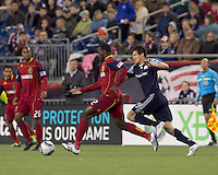 Real Salt Lake midfielder Jean Alexandre (12) dribbles as New England Revolution midfielder Marko Perovic (29) pressures. In a Major League Soccer (MLS) match, Real Salt Lake defeated the New England Revolution, 2-0, at Gillette Stadium on April 9, 2011.
