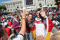 San Francisco, CA - Thursday, June 26, 2014:  Germany soccer fans (left to right) Julian Blankenhorn and Kevin Braun of Germany celebrate Germany's goal while watch the USA vs. Germany first round World Cup match at a public viewing at the Civic Center in San Francisco, CA