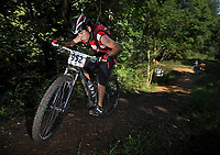 STAFF PHOTO BEN GOFF  @NWABenGoff -- 09/07/14  Riders take on the President Bush Push during Slaughter Pen Jam, part of the Arkansas Mountain Bike Championship Series, on the Slaughter Pen trails in Bentonville on Sunday September 7, 2014.