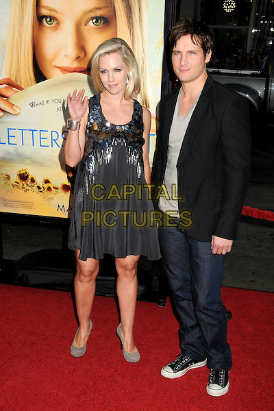 "JENNIE GARTH & PETER FACINELLI .Attending ""Letters To Juliet"" Los Angeles Premiere held at Grauman's Chinese Theatre, Hollywood, California , USA, .11th May 2010..arrivals full length married couple husband wife silver gold grey gray sequined sequin paillettes dress black jacket blazer blue navy silver hand waving jeans trainers converse metal discs embellished .CAP/ADM/BP.©Byron Purvis/AdMedia/Capital Pictures."