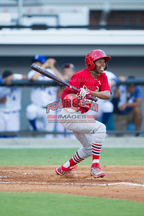 Anthony Ray (3) of the Johnson City Cardinals follows through on his swing against the Burlington Royals at Burlington Athletic Park on July 14, 2014 in Burlington, North Carolina.  The Cardinals defeated the Royals 9-4.  (Brian Westerholt/Four Seam Images)