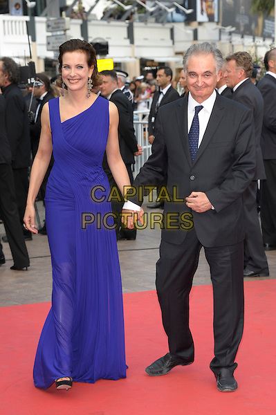 CAROLE BOUQUET & JACQUES ATTALI .arrives at the 'Sleeping Beauty' premiere during the 64th Annual Cannes Film Festival at the Palais des Festivals in Cannes, France, May 12, 2011..full length blue long maxi dress holding hands grey gray suit tie .CAP/PL.©Phil Loftus/Capital Pictures.
