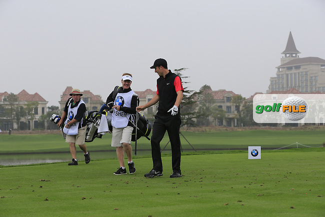 Ross Fisher (ENG) walks off the 6th tee during Saturay's Round 3 of the 2014 BMW Masters held at Lake Malaren, Shanghai, China. 1st November 2014.<br /> Picture: Eoin Clarke www.golffile.ie