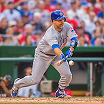 15 June 2016: Chicago Cubs catcher David Ross lays down a sacrifice bunt against the Washington Nationals at Nationals Park in Washington, DC. The Cubs fell to the Nationals 5-4 in 12 innings, giving up the rubber match of their 3-game series. Mandatory Credit: Ed Wolfstein Photo *** RAW (NEF) Image File Available ***