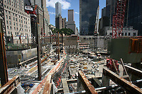 Tenth anniversary of 9/11.  Rebuilding at the World Trade Center site. View is east, with construction of 2 World Trade Center underway, at left.  The tallest luxury residential tower in New York City,  designed by the architect Frank Gehry, is at left center in photograph in background.  Photo by Ari Mintz.  8/11/2011