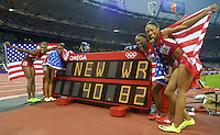 The 4x100m Relay team of Tianna Madison, Carmelita Jeter, Bianca Knight(Longhorn) and Allyson Felix set a world record with a time of 40.82sec. at the 2012 London Olympic Games on Friday, August 10, 2012. Photo by Errol Anderson.