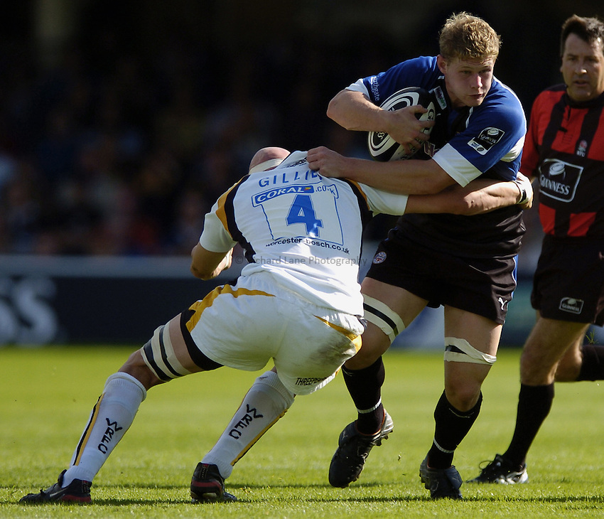 Photo: Jonathan Butler..Bath Rugby v Worcester Warriors. Guinness Premiership. 23/09/2006..Chris Goodman of Bath is tackled by Craig Gillies of Worcester.