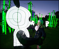 BNPS.co.uk (01202 558833)<br /> Pic: PhilYeomans/BNPS<br /> <br /> Leigha Swanson(6) meets an illuminated panda.<br /> <br /> The largest Chinese 'Festival of Light' seen in Europe is taking shape at the Longleat House in Wiltshire - A small army of over 50 skillled workers have flown in from the remote village of Zigong in central China to create the stunning spectacle.<br /> <br /> Among the different scenes are a 20-metre tall Chinese temple, a 70-metre-long dragon, created using more than 10,000 porcelain cups, bowls, plates and dishes, and the mythical qilin &ndash; a chimerical hooved creature with the head of a lion &ndash; featuring more than 30,000 glass phials filled with coloured liquid.<br /> <br /> Massive traditional Chinese masks are also featured and there is also a bamboo forest which is home to a family of life-size pandas, giant elephants, zebras, lions and deer as well as giant lotus flowers floating on the lake.<br /> <br /> Filled with thousands of LED lights and handmade by a team of 50 highly-skilled craftsmen from Zigong in China's Sichuan province, the lanterns recreate a magical world of myths and legends.<br /> <br /> Set amid the beautiful backdrop of the landscaped grounds and gardens surrounding Longleat House, the lit structures also spill out on to Half Mile Lake to create a stunning and enchanting experience for visitors.<br /> <br /> It&rsquo;s the first time a festival of this size has taken place in the UK and the Chinese team behind the spectacular event believe its size and complexity make it unique throughout Europe.