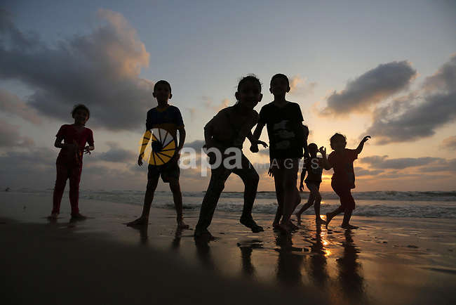 Palestinians enjoy their time of the beach of Gaza city, on July 5, 2017. An immediate consequence of the electricity cuts has been suffering for Gazans. A new U.N. report said Gaza gets electricity just four to six hours a day, and 29 million gallons of sewage is flooding into the Mediterranean Sea every day and threatening to overflow into the streets. Photo by Ashraf Amra