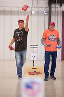 NWA Democrat-Gazette/BEN GOFF @NWABENGOFF<br /> Tim Miller (left) of Centerton, with the Northwest Arkansas group Cornhole Mafia, and Randy Jones with Jersey County Cornhole from Illinois, take practice tosses Friday, March 9, 2018, during the American Cornhole Organization's Bentonville Major at the Benton County Fairgrounds and Expo Center in Bentonville. The tournament continues Saturday with World Doubles and World Singles divisions. Organizers say spots are still open to enter Saturday's events, with no entry fee, if cornholers show up by 9:30 a.m.