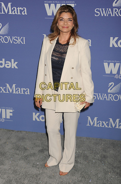 Laura San Giacomo<br /> arriving at Women In Film's 2013 Crystal and Lucy Awards at The Beverly Hilton Hotel in Beverly Hills, California, USA, June 12th, 2013.<br /> full length cream beige jacket trousers suit black top <br /> CAP/ROT/TM<br /> &copy;Tony Michaels/Roth Stock/Capital Pictures