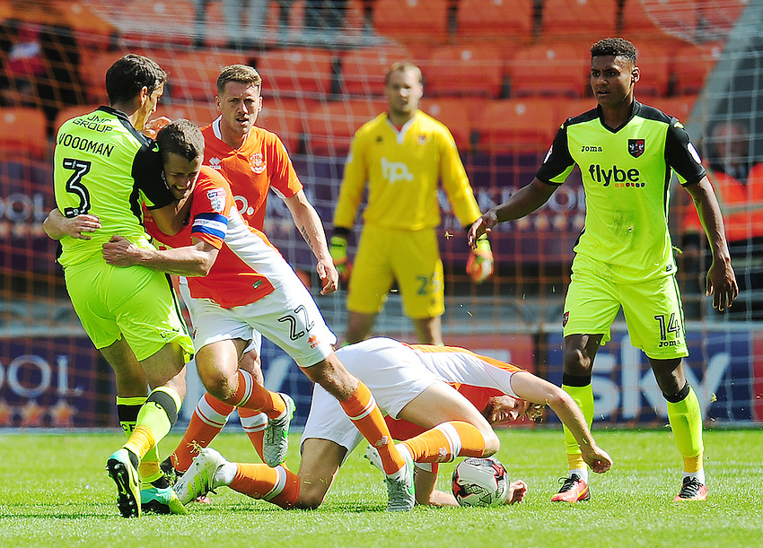 Exeter City's Craig Woodman is fouled by Blackpool's Danny Pugh<br /> <br /> Photographer Kevin Barnes/CameraSport<br /> <br /> Football - The EFL Sky Bet League Two - Blackpool v Exeter City - Saturday 6th August 2016 - Bloomfield Road - Blackpool<br /> <br /> World Copyright &copy; 2016 CameraSport. All rights reserved. 43 Linden Ave. Countesthorpe. Leicester. England. LE8 5PG - Tel: +44 (0) 116 277 4147 - admin@camerasport.com - www.camerasport.com