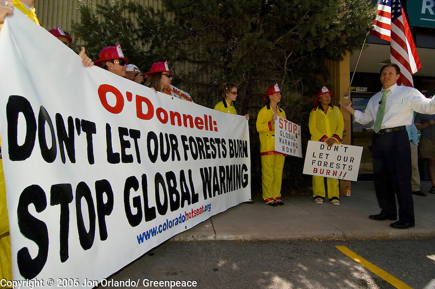 Greenpeace activist  meet with Rick O'Donnell, a Republican congressional candidate for district 7 in Colorado, to demonstrate their concerns regarding  the threats of global warming.
