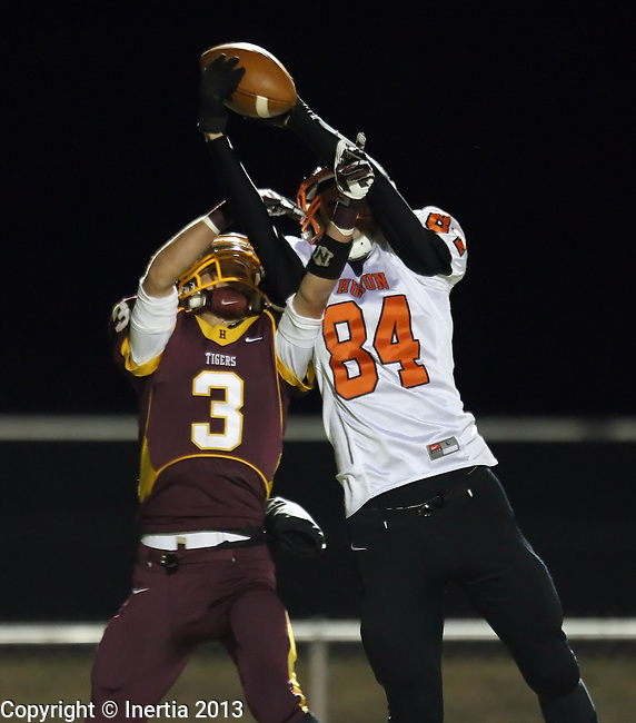 SIOUX FALLS, SD - OCTOBER 31:  Hunter Christensen #3 from Harrisburg battles for the ball with Caleb Carr #84 from Huron in the first quarter of their quarterfinal round game of the 11AA Playoffs Thursday night in Harrisburg. (Photo by Dave Eggen/Inertia)