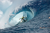 Surfing at the infamous Teahupoo break located at the End of The Road on the south west corner of Tahiti Iti in French Polynesia.  Photo: Joli