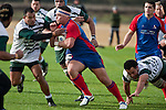Suli Tuafele makes good yards upfield. Counties Manukau Premier Club Rugby game between Ardmore Marist and Manurewa, played at Bruce Pulman Park, Papakura on Saturday July 18th 2009..Ardmore Marist won the game 32 - 5 after leading 10 - 5 at halftime.
