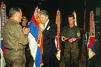 "Yougoslavia. Bosnia. Serbian republic. Bijelina. Radovan Karadzic (C) and General Ratko Mladic (L). Celebration for ""Vidovdan"" day. Each year on the 28th of June, the serbs celebrate the day of the army. Religious service in the orthodox church. Radovan Karadzic is kissing the serbian flag while the general Ratko Mladic is clapping his hands. Radovan Karadzic was arrested in Belgrade on 21 July 2008. He was extradited to the Netherlands, and is currently in The Hague, in the custody of the International Criminal Tribunal for the former Yugoslavia. General Ratko Mladic is on the list of the International Criminal Tribunal for the former Yugoslavia (ICTY), based in The Hague in the Nederlands, as a most wanted man for war crimes. © 1995 Didier Ruef"