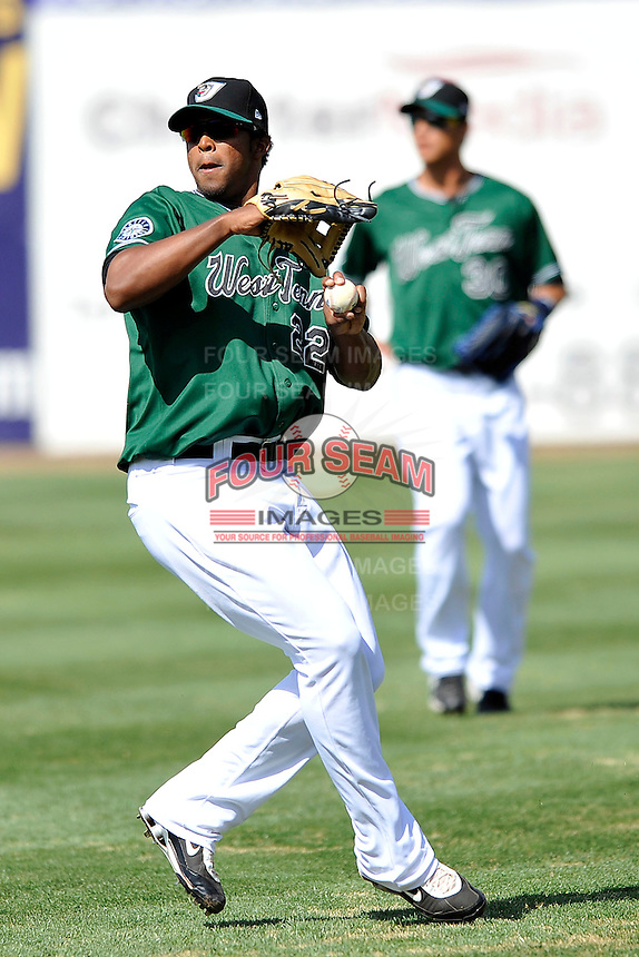 Carlos Peguero #22 of the West Tenn Diamond Jaxx in action versus the Mississippi Braves at Pringles Park April 18, 2010 in Jackson, Tennessee. (Photo by Grant Halverson / Four Seam Images)