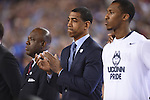 07 April 2014: Coach Kevin Ollie of the University of Connecticut applauds the National Anthem against the University of Kentucky during the 2014 NCAA Men's DI Basketball Final Four Championship at AT&T Stadium in Arlington, TX. Connecticut defeated Kentucky 60-54 to win the national title. Peter Lockley/NCAA Photos