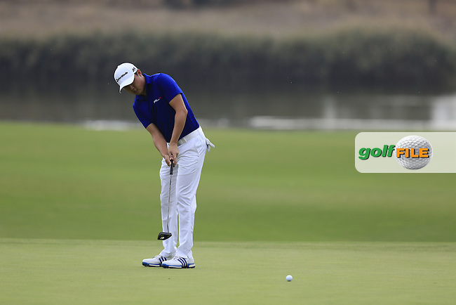 David Lipsky (USA) putts on the 14th green during Friday's Round 2 of the 2016 Portugal Masters held at the Oceanico Victoria Golf Course, Vilamoura, Algarve, Portugal. 21st October 2016.<br /> Picture: Eoin Clarke | Golffile<br /> <br /> <br /> All photos usage must carry mandatory copyright credit (&copy; Golffile | Eoin Clarke)
