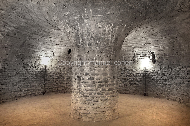 11th century Crypt of Pessebre, Benedictine Abbey of Saint Michel de Cuxa, Codalet, Pyrenees Orientales, France. Circular chapel of rough stone with vault, supported by an enormous central pillar. Picture by Manuel Cohen