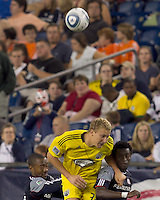 New England Revolution defender Cory Gibbs (12), Columbus Crew forward Steven Lenhart (32), and New England Revolution defender Emmanuel Osei (5) battle for head ball. The New England Revolution tied Columbus Crew, 2-2, at Gillette Stadium on September 25, 2010.