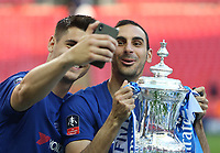 Chelsea's Alvaro Morata and Davide Zappacosta take a selfie with the trophy<br /> <br /> Photographer Rob Newell/CameraSport<br /> <br /> Emirates FA Cup Final - Chelsea v Manchester United - Saturday 19th May 2018 - Wembley Stadium - London<br />  <br /> World Copyright &copy; 2018 CameraSport. All rights reserved. 43 Linden Ave. Countesthorpe. Leicester. England. LE8 5PG - Tel: +44 (0) 116 277 4147 - admin@camerasport.com - www.camerasport.com