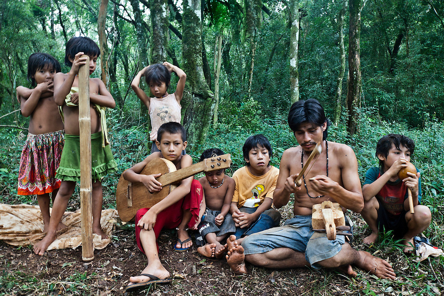 Mbya Guarani residents of aldea Katupyry near San Ignacio, Misiones, Argentina, with traditional instruments hand-made in the community by a local elder.