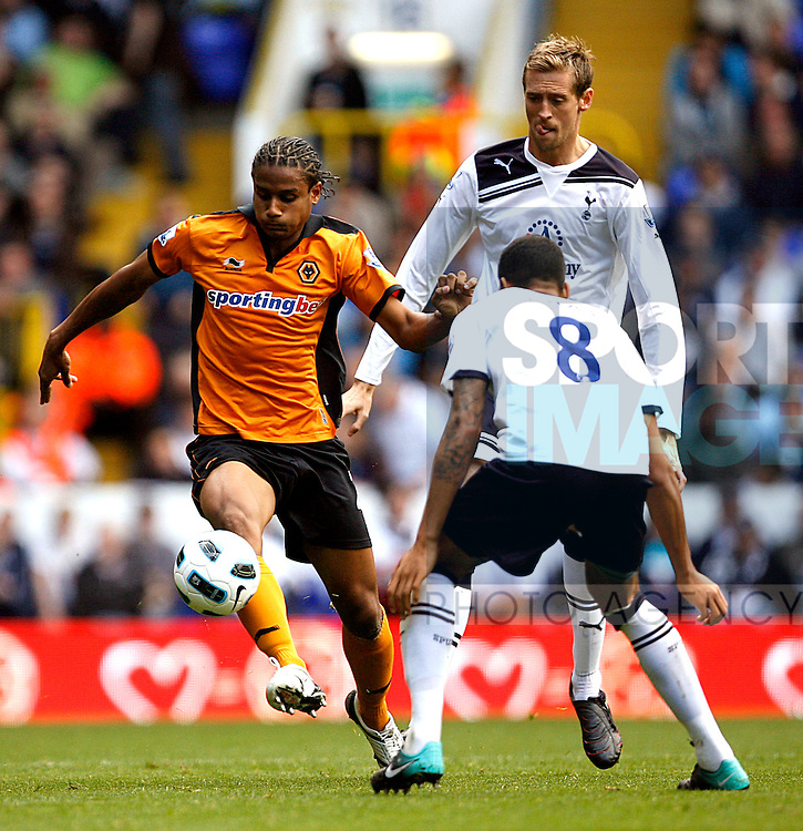 Michael Mancienne of Wolverhampton Wanderers holds off Peter Crouch of Tottenham Hotspur