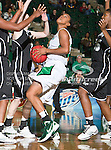North Texas Mean Green guard Desiree Nelson (32) in action during the game between the Troy Trojans and the University of North Texas Mean Green at the North Texas Coliseum,the Super Pit, in Denton, Texas. UNT defeats Troy 57 to 36.....