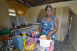 Marie Joseph Joseph poses in the kitchen of her new house built by Servicio Social de las Iglesis Dominicanas in the Haitian community of Ganthier. SSID, a member of the ACT Alliance, has worked extensively in the community since it was devastated in 2016 by Hurricane Matthew.
