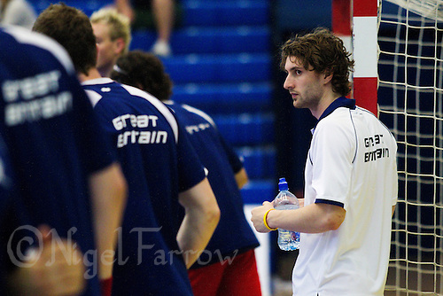 11 JUN 2010 - LONDON, GBR - Injured player Mark Hawkins watches the British team warmup before their 2012 European Handball Championships Qualification Tournament match against Estonia (PHOTO (C) NIGEL FARROW)