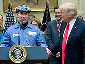 """A coal miner identified only as Mike makes remarks prior to United States President Donald J. Trump signing H.J. Res. 38, disapproving the rule submitted by the US Department of the Interior known as the Stream Protection Rule in the Roosevelt Room of the White House in Washington, DC on Thursday, February 16, 2017.  The Department of Interior's Stream Protection Rule, which was signed during the final month of the Obama administration, """"addresses the impacts of surface coal mining operations on surface water, groundwater, and the productivity of mining operation sites,"""" according to the Congress.gov summary of the resolution.<br /> Credit: Ron Sachs / Pool via CNP"""