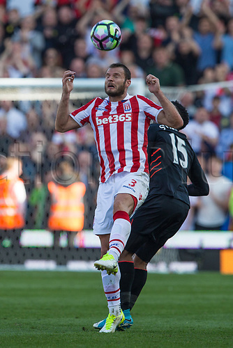 April 8th 2017, bet365 Stadium, Stoke on Trent, Staffordshire, England; EPL Premier League football, Stoke City versus Liverpool; Stoke City's Erik Pieters wins the header from Sturridge of Liverpool