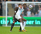 10th September 2017, Liberty Stadium, Swansea, Wales; EPL Premier League football, Swansea versus Newcastle United; Tammy Abraham of Swansea City holds up the ball despite the pressure from Jamaal Lascelles (captain) of Newcastle United