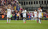 Pictured L-R: Federico Fernandez, Modou Barrow and Jack Cork thank their away supporters at the end of the game<br />