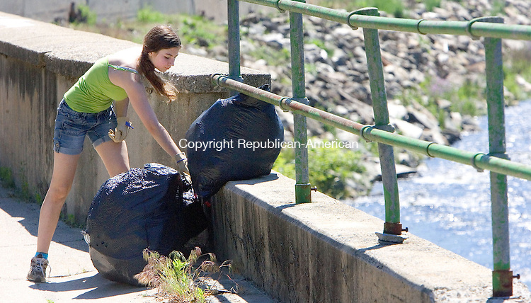 TORRINGTON CT. 01 June 2013-060113SV05-Courtney Stenman, 15, of Winsted collects garbage bags full of debris pulled from the river during the 7th Annual Naugatuck River Cleanup in Torrington Saturday. Volunteers fanned out along the Naugatuck River to pull out shopping carts and whatever other errant debris they can find.<br /> Steven Valenti Republican-American